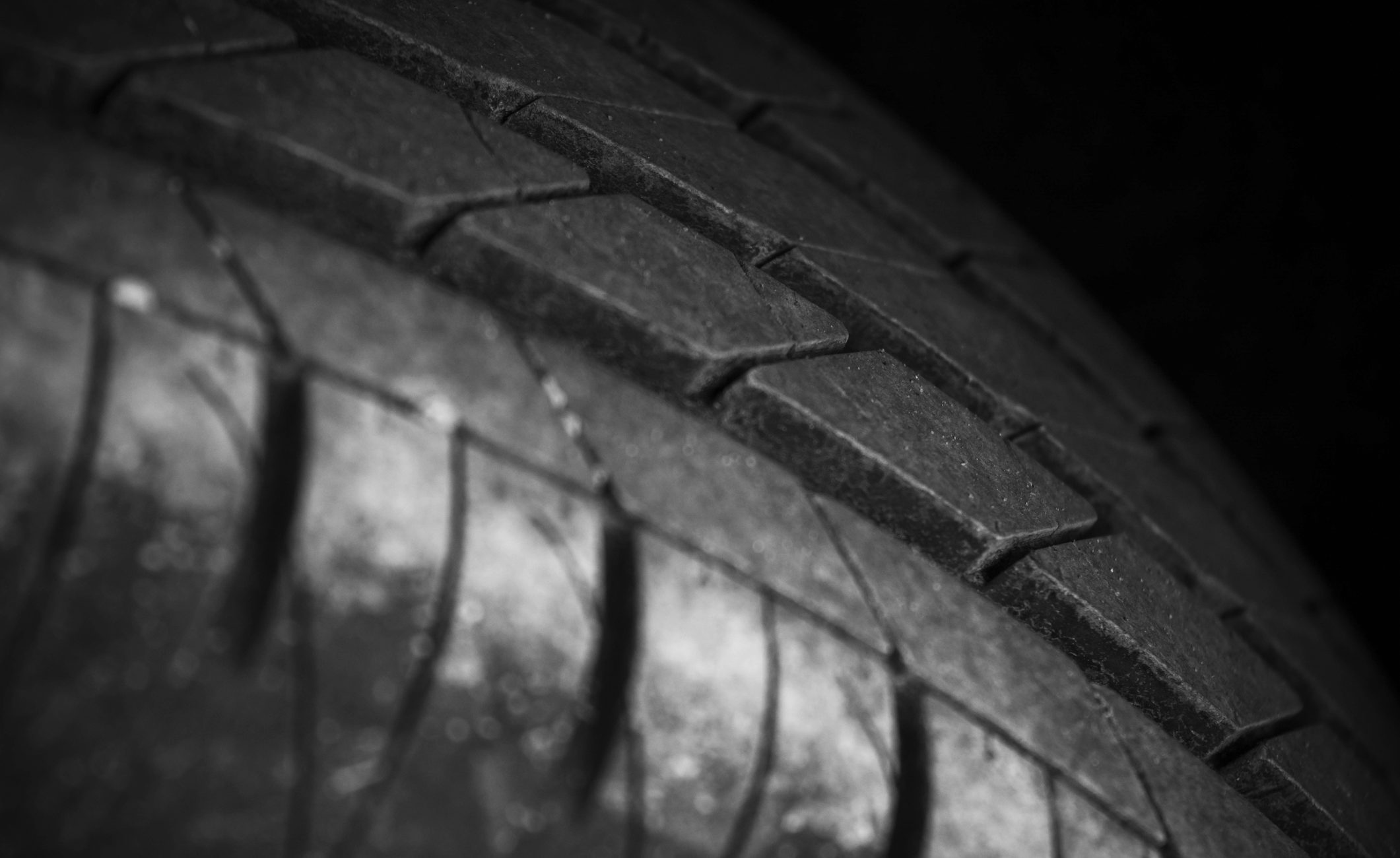 close up shot of a black car tyre